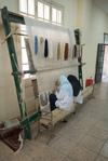 Tying a silk rug