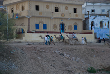 Tourist camel riders in a Nubian village