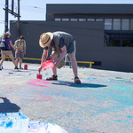 Tim paints the parking lot
